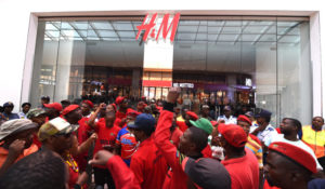 JOHANNESBURG, SOUTH AFRICA JANUARY 15: (SOUTH AFRICA OUT): Economic Freedom Fighters (EFF) members protest against the H&M store in the Mall of Africa on January 15, 2018 in Johannesburg, South Africa. EFF members vandalised various H&M stores after an advert with an African boy wearing a sweatshirt with Coolest Monkey in the Jungle written on it sparked racist complaints. (Photo by Felix Dlangamandla/Foto24/Gallo Images/Getty Images)